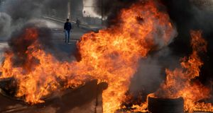 Protesters burn tires to close a main road, after the Lebanese pound hit a record low against the dollar on the black market, in Beirut, Lebanon on March 6th. Photograph: Hassan Ammar/AP