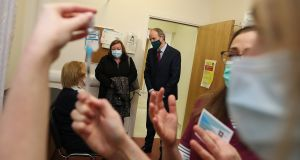 Taoiseach Micheál Martin (centre) at the Meath Primary Care Centre in Dublin. Photograph: Julien Behal