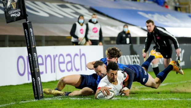Robert Baloucoune dives to score for Ulster against Leinster. Photograph: James Crombie/Inpho