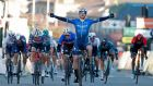 Team Deceuninck rider Ireland's Sam Bennett celebrates as he crosses the finish line at the end of the first stage of the 79th Paris - Nice race between Saint-Cyr-lEcole and Saint-Cyr-lEcole. Photo: Bas Czerwinski/AFP via Getty Images