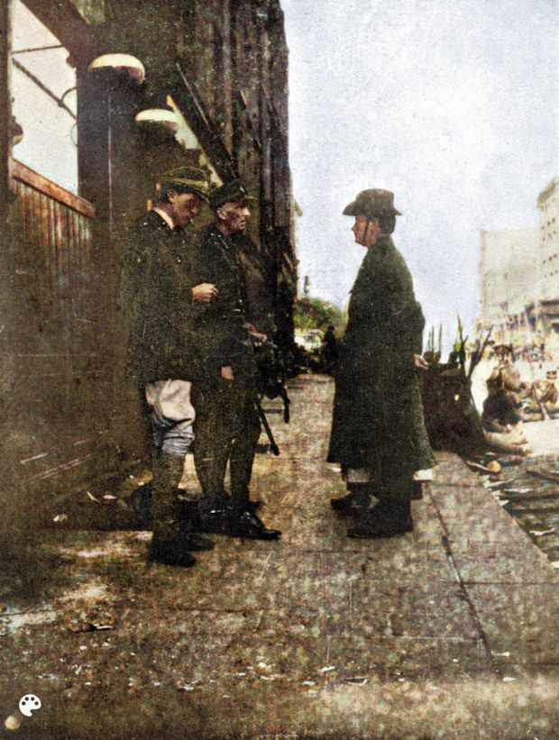 The photograph of the Pearse surrender in 1916 in which the legs and boots of nurse Elizabeth Farrell were frequently excised from the picture. Artist Sinead Guckian has turned the picture around and painted it from the nurse's perspective