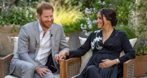 Oprah with Meghan and Harry: the couple are charming, clever and good at being celebrities. Photograph: Joe Pugliese/Harpo via AP