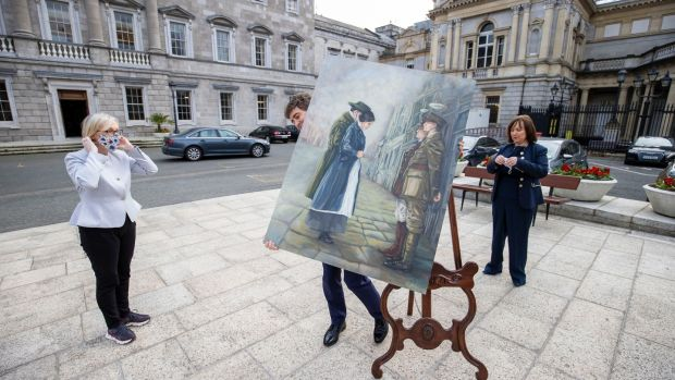 "Senator Mark Daly carries the painting ""Her Surrender"" by Sinéad Guckian from the Dáil plinth with Senator Regina Doherty (left) and Senator Fiona O'Loughlin looking on. Photo: Tom Honan/The Irish Times."