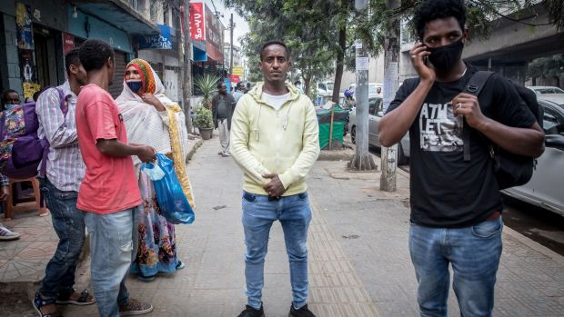Witnesses in the street outside Addis Ababa's federal court, following a hearing in the smuggler trials. Photograph: Sally Hayden