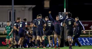 Edinburgh celebrate their late winning try against Connacht. Photograph: James Crombie/Inpho