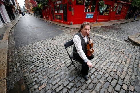 ROCKY ROAD IN DUBLIN: Marking exactly one year since the Temple Bar area of Dublin was effectively shut down during the first Covid-19 lockdown, world-renowned fiddler Frankie Gavin draws attention to the plight of musicians, whose livelihoods have been devastated. Photograph: Nick Bradshaw