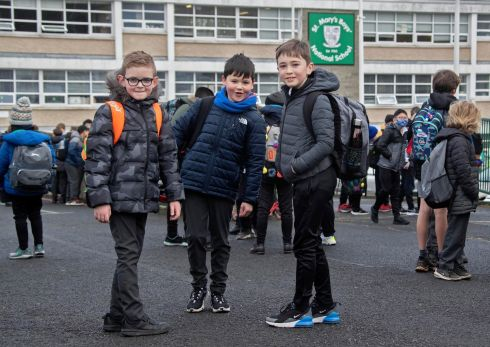 BACK TO ACTUAL SCHOOL: Tom Weir (10), Aaron O'Byrne (10) and Odhran Keegan (10), third-class pupils at St Mary's Boys National School in Lucan, return to school for the first time in almost three months as certain Covid-19 restrictions are eased. Photograph: Colin Keegan/Collins Dublin