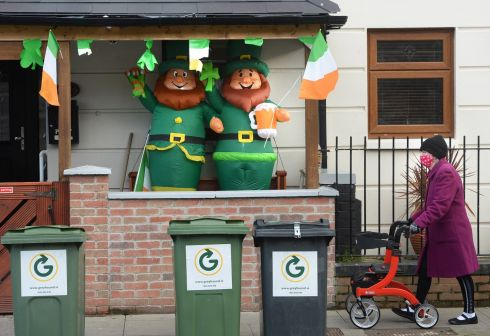 GONE, NOT FORGOTTEN: St Patrick's Day decorations festoon a house at Oriel Street Upper, Dublin. St Patrick's Day festivities are not again not being held on the streets of Dublin or around the country this year due to Covid-19. Photograph: Dara Mac Dónaill