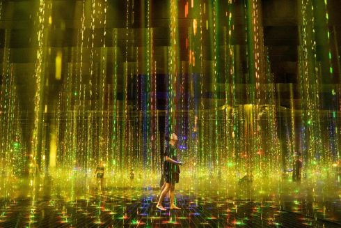 INTO THE LIGHT: Staff members in an interactive installation entitled Ephemeral Solidified Light during a media preview of the teamLab Reconnect: Art with Rinkan Sauna experience, organised by teamLab and Tiktok, in the Roppongi district of Tokyo, Japan. Photograph: Philip Fong/AFP/Getty