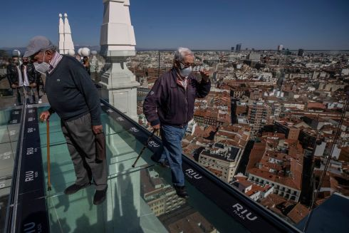 WALK TALL: Residents of nursing homes take their first steps outside after being vaccinated for Covid-19, with the skyline of Madrid in the background, in Madrid, Spain. Care home managers felt it was time for them to enjoy a trip into the city after the lengthy lockdown. Photograph: Manu Fernandez/AP Photo