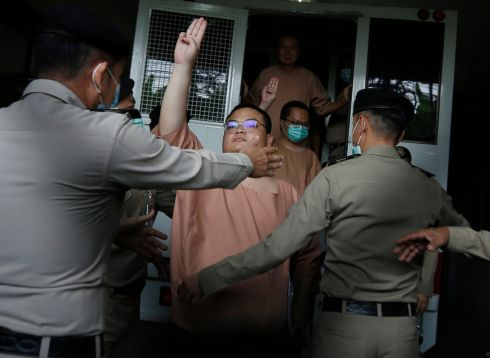 HUNTERS OF DEMOCRACY: A leader of Thai pro-democracy activists, Parit