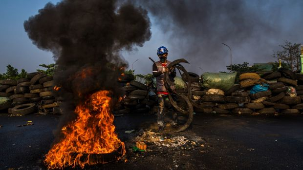 Protesters burn tyres on a bridge in an attempt to block security forces from passing through a major traffic hub in Yangon on Wednesday. Photograph: The New York Times