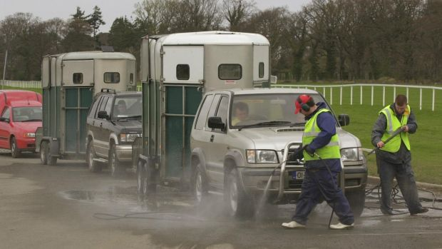 Horseboxes are sprayed on arrival at Leopardstown Racecourse where racing took place on April 15, 2001, after a seven-week break because of foot-and-mouth disease. Photograph: Bryan O'Brien
