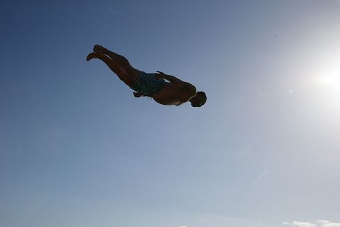 DIVE IN: Nickloas Reuland pictured diving from Dún Laoghaire pier. Photograph: Stephen Collins/Collins Photos