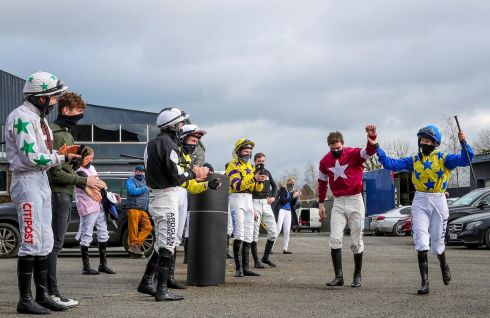 FESTIVAL ACES: Jockeys at a Thurles race meeting on Saturday form a guard of honour for Cheltenham Gold Cup-winning rider Jack Kennedy and Rachael Blackmore, who was leading rider at the Cheltenham Festival. Photograph: Caroline Norris/Inpho