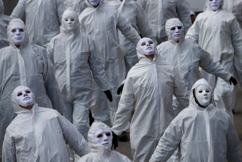 NO MORE LOCKDOWN: Protesters dressed in white take part in a demonstration against ongoing coronavirus restrictions, in Liestal, Switzerland. Between 3,000 and 5,000 people, some wearing white suits, took part in the silent demonstration. Photograph: Stefan Wermuth/AFP via Getty