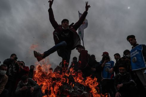 "HOT STUFF: A supporter of the pro-Kurdish Peoples' Democratic Party (HDP) jumps over a bonfire during celebrations of Nowruz, the Kurdish New Year, in Istanbul, Turkey. Nowruz, which means ""new day"" in Persian, marks the arrival of spring and the first day of the year in the Iranian calendar. Photograph: Sedat Suna/EPA"