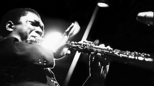 'Making lunch with John Coltrane playing makes it feel like a proper Sunday': John Coltrane performs on stage at the Half Note club, New York in 1965. Photograph: Adam Ritchie/Redferns