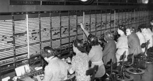 Telephone operators receiving long distance calls at a  London exchange in 1946. More telephones meant even more switchboard operators.  Photograph: Getty Images