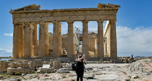 Quiet tourist season: a visitor takes a selfie in front of the Parthenon temple, in Athens, on Monday. Photograph: Milos Bicanski/Getty