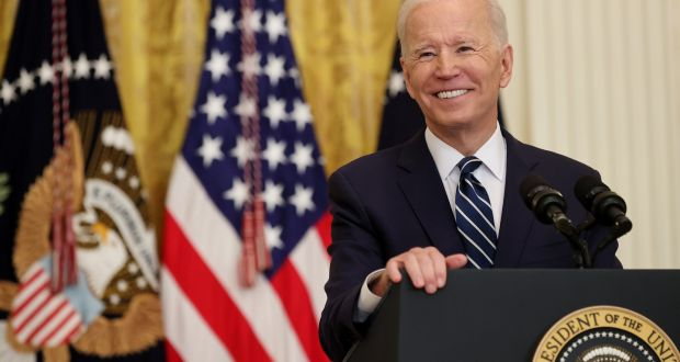 US president Joe Biden smiles during the first news conference of his presidency in the East Room of the White House on Thursday. Photograph:  Chip Somodevilla/Getty Images
