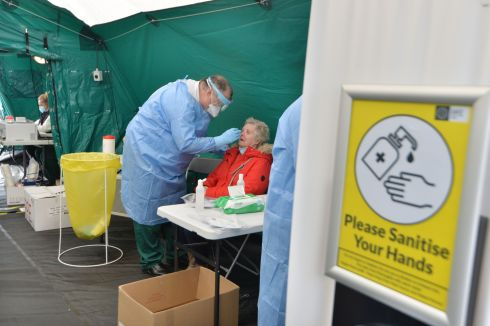 TESTING: A member of the National Ambulance Service gives Christine Cutler a Covid-19 test at a walk-in test centre in Tullamore, Co Offaly. Photograph: Alan Betson