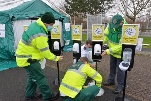 CLEAN HANDS: Members of the National Ambulance Service sanitise their hands at the walk-in Covid-19 test centre in Tullamore, Co Offaly. Photograph: Alan Betson