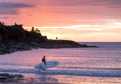 GOOD MORNING: Roger Griffen from Crosshaven watches the sunrise at Fountainstown, Co Cork, before setting out to paddleboard in the calm ocean. Photograph: David Creedon/Anzenberger