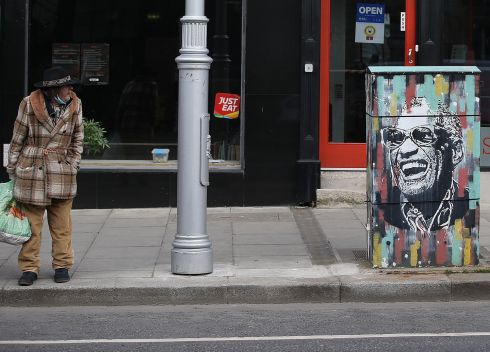 HIT THE ROAD: A pedestrian observes the Ray Charles mural in Ranelagh, Co Dublin. Photograph: Stephen Collins/Collins Photos