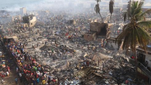 AFTERMATH: People look on at the aftermath of a large fire that broke out in an informal settlement in Susan's Bay, Freetown, Sierra Leone. Photograph: Saidu Bah/AFP via Getty