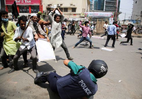 PROTEST: Student activists clash with police during a demonstration against the upcoming visit of Indian PM Narendra Modi, in Dhaka, Bangladesh. Photograph: AFP/via Getty