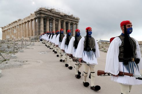 INDEPENDENCE: Presidential Guard members walk in front of the Parthenon, as Greece marks the 200th anniversary of the start of its war of independence. Photograph: Petros Giannakouris/AP Photo