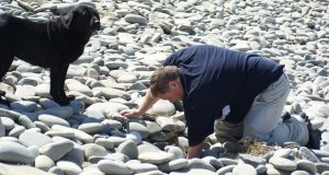 Beachcomber Patrick Lillis of Celtic Ambergris, with his dog, Dash, is a seasoned beachcomber from Co Clare and an authority on ambergris, which he hunts for on Irish coasts