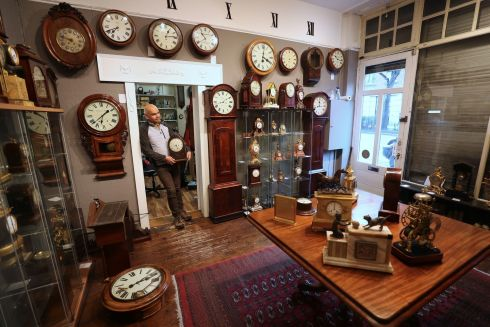 Kevin Chellar stands in his closed shop Timepiece Antique Clocks on Patrick Street, Co Dublin. Clocks will go forward by one hour on Sunday March 29th. Photograph: Nick Bradshaw/The Irish Times