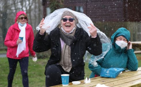 Mairead O'Donovan, Bridget Gleeson and Betty Tuite caught in a hail shower this afternoon in Santry, Co Dublin. Photograph: Nick Bradshaw/The Irish Times