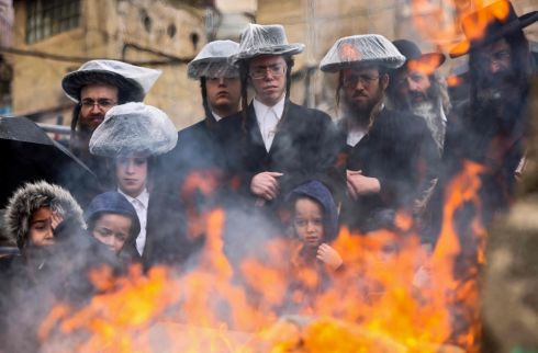 Ultra-Orthodox Jewish men burn leavened items during the Biur Chametz ritual in Jerusalem, Israel, before the Jewish Pesach (Passover) holiday. Photograph: Emmanuel Dunand/AFP via Getty