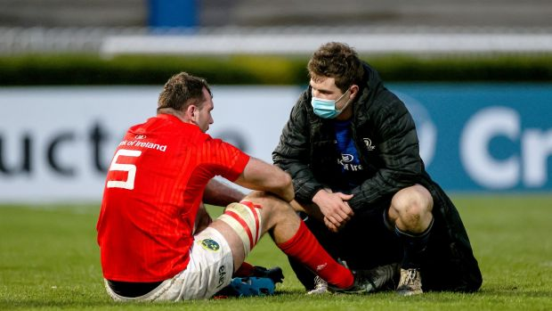 Luke McGrath consoles Tadhg Beirne after Leinster's Pro14 final win over Munster. Photograph: Billy Stickland/Inpho