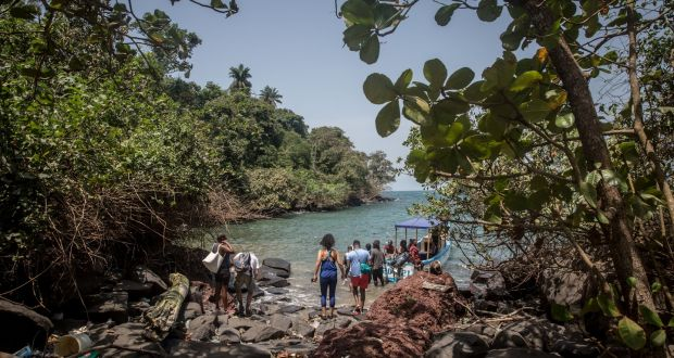 Tourists board a boat on the coast of the Banana Islands. Photograph: Sally Hayden