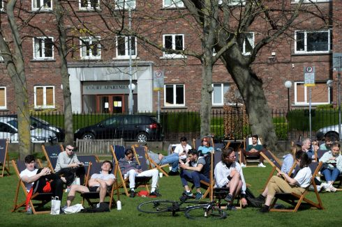 HIT THE DECK: People take to deckchairs to soak up the sun at Wilton Park, Dublin. Photograph: Dara Mac Donaill