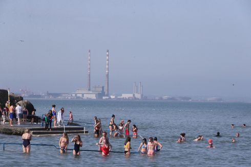 TAKE A DIP: People go for a swim at Seapoint Beach, Dublin. Photograph: Niall Carson/PA Wire