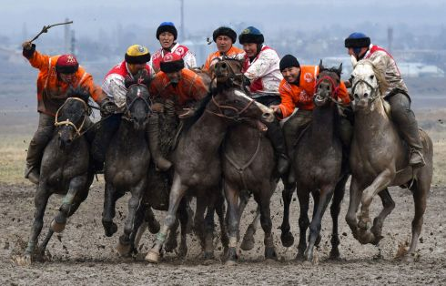 FIERCE COMPETITION: Riders play the traditional Central Asian sport of kok-boru, or buzkashi, in the village of Sokuluk in Kyrgyzstan. Kok-boru is a traditional game where players on horseback compete for points by manoeuvring a stuffed sheepskin into the opponent's goal. Photograph: Vyacheslav Oseledko /AFP via Getty