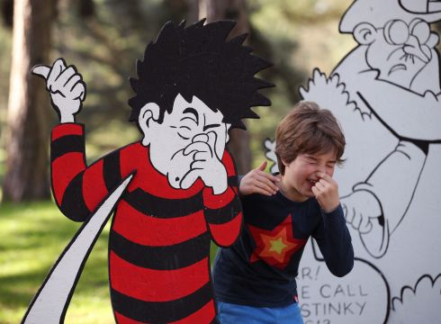DENNIS THE MENACE: Children playing with a 3D comic strip of the Beano during the Easter festival at Kew Gardens in south-west London. This year's festival celebrates 70 years of Dennis the Menace with a series of activities and an interactive story trail around the gardens. Photograph: Yui Mok/PA Wire