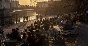 People sit in the sun in Berlin: From Friday, the city has banned all gatherings of more than two people between 9pm and 5am. Photograph: Maja Hitij/Getty