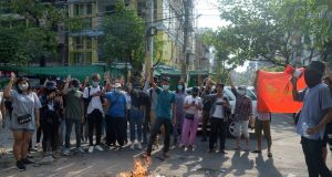 Anti-coup protesters burn constitution books at Tarmwe township in Yangon, Myanmar. Photograph: AP Photo