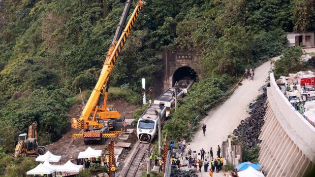 Rescue workers remove part of a derailed train in Taiwan. Photograph: Chiang Ying-ying/AP Photo