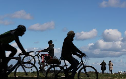 ONE WHEEL GOOD: Time for a wheelie as other cyclist pass by in the Phoenix Park, Dublin. Photograph: Nick Bradshaw