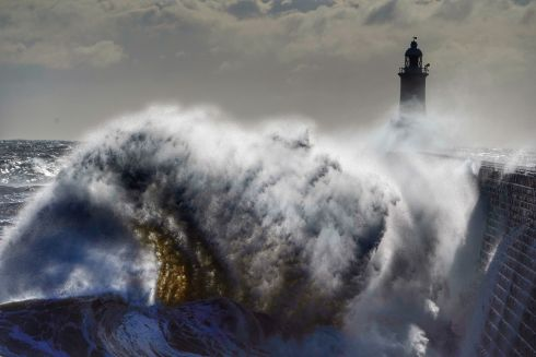 BRITISH SEA POWER: Waves from the North Sea crash against the Tynemouth Lighthouse, Tynemouth, Northumberland, on the northeast coast of England, where cold winds brought freezing temperatures on Easter Monday. Photograph: Owen Humphreys/PA Wire