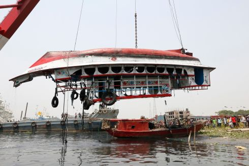 FERRY SINKING: A crane lifts a capsized ferry boat from the Shitalakkhya river in Narayanganj, Dhaka, Bangladesh. The ferry, carrying about 50 passengers, sank and left 26 people dead, police officials said. Photograph: Monirul Alam/EPA