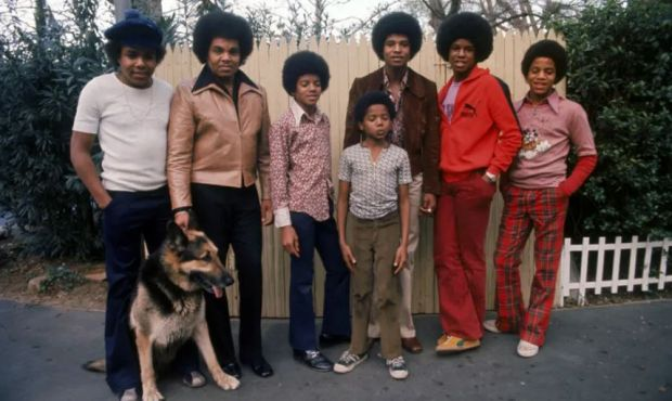 The Jacksons with their father Joe in their backyard, 1972: (left to right) Tito, Joe, Michael, Randy, Jackie, Jermaine and Marlon. Photograph: Getty Images