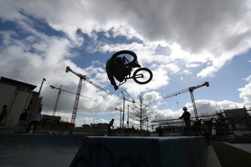 RIDING HIGH: BMX biker Eoin Flynn in action at Dublin's Weaver Square. Photograph: Nick Bradshaw